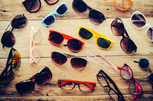 Many Sunglasses Fashion And Eyeglasses On The Wood