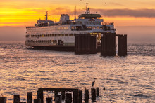 Car Ferry Leaving Dock At Sunset