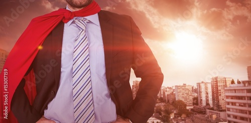 Fotografie, Obraz  Composite image of happy businessman wearing cape and eye mask