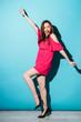 Smiling positive woman in dress dancing and having fun