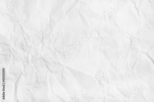 Valokuva  White Crumpled paper texture. Flat lay, top view.