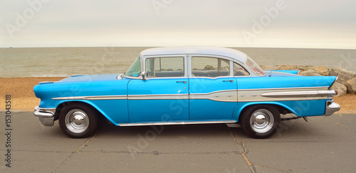 Photo Classic Blue Pontiac Star Chief Motor Car  parked on seafront promenade