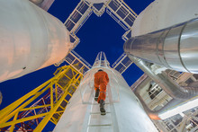 Engineering Climb Up To Oil And Gas Process Plant To Observer Gas Dehydration Processing In Night Shift