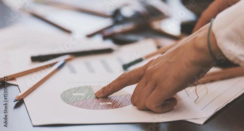 Fototapeta Girl working concept - business reports and charts. obraz na płótnie
