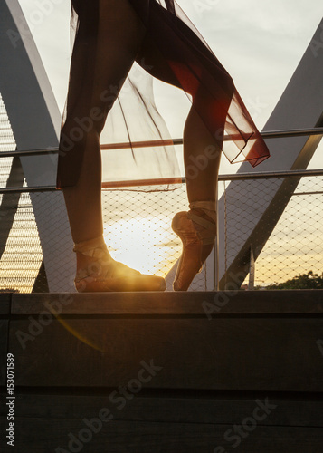 Keuken foto achterwand Schip ballerina woman performing a pose with old classic shoes on a metal bridge