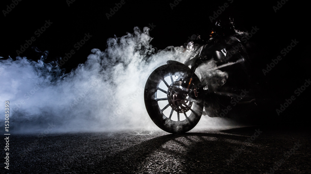 Fototapeta High power motorcycle chopper with man rider at night