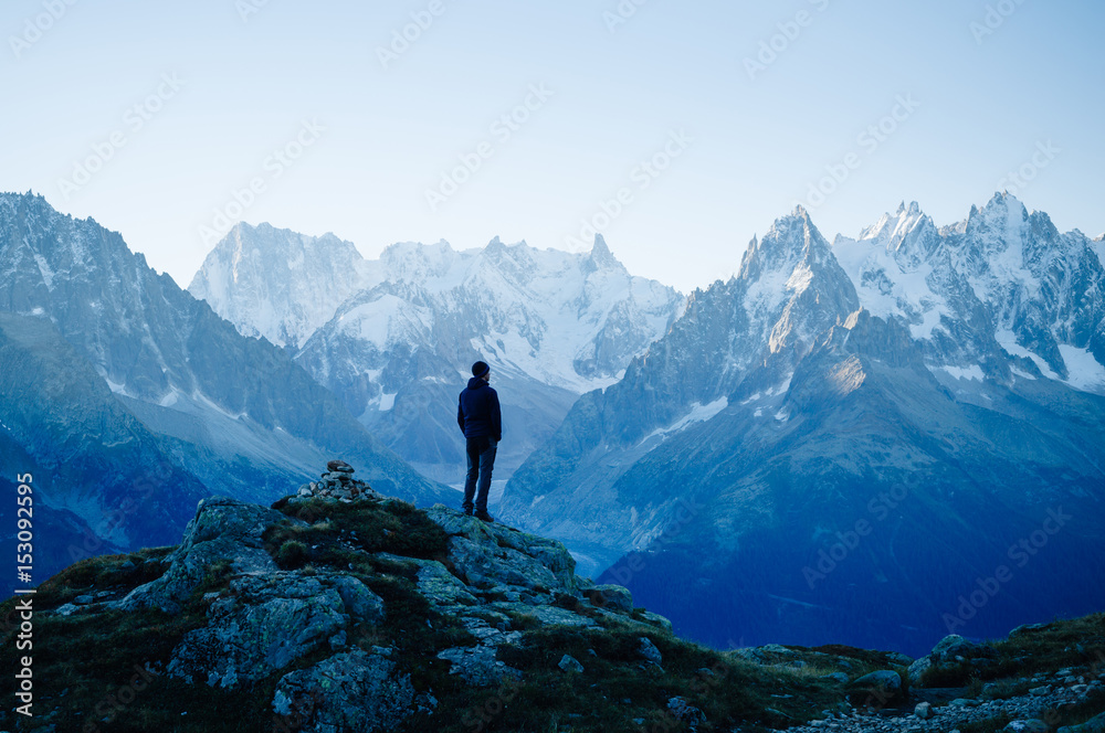 Fototapety, obrazy: Man looking at the mountains near Chamonix, France. Old film style.