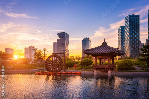 Seoul city with Beautiful sunset, traditional and modern architecture at central park in songdo International business district, Incheon South Korea Wallpaper Mural