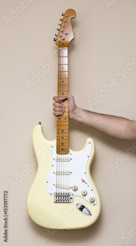 Hand Holding White Vintage Electric Guitar Wallpaper Mural