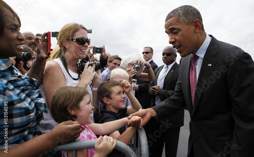 U S  President Barack Obama shakes hands after arriving at