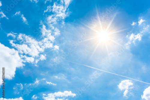 Fotografering  Sunny background, blue sky with white clouds and sun