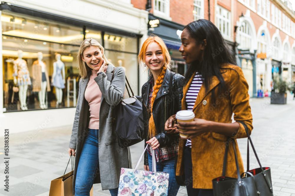 Fototapeta Girls shopping and walking in the city