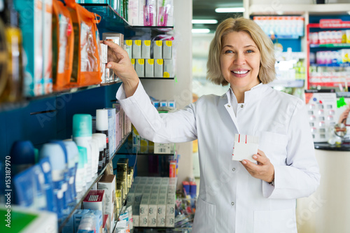 Pharmaceutist in pharmacy drugstore
