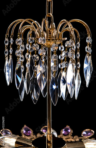 Contemporary Gold Chandelier Isolated On Black Background Crystal Decorated Purple Crystals Close Up
