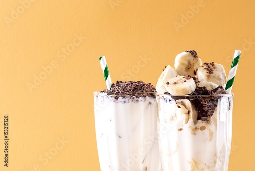 Three milkshakes on a bright background