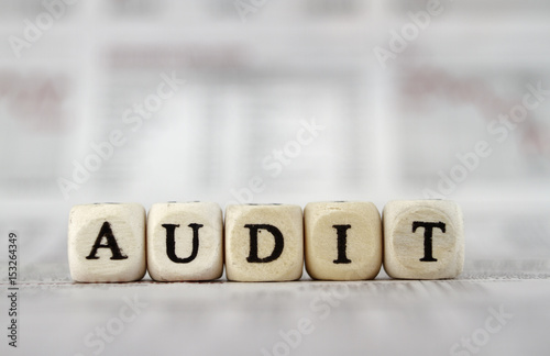 Audit word built with letter cubes on newspaper background - Buy