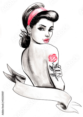 Photo  Pinup beauty with a rose tattoo