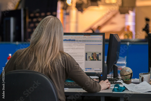 A journalist working on a computer in Newsroom