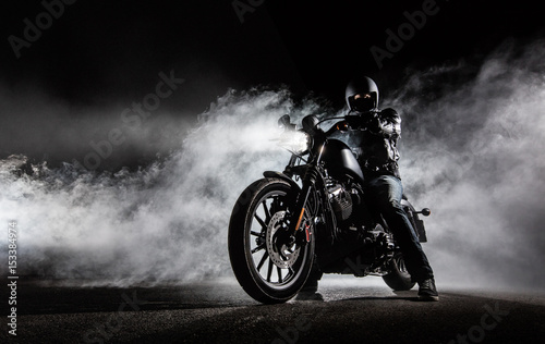 High power motorcycle chopper with man rider at night Fotobehang