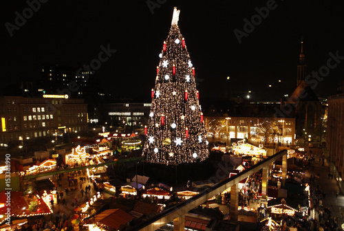 a decorated christmas tree stands at a christmas market on its opening day in dortmund - Decorative Christmas Tree Stands