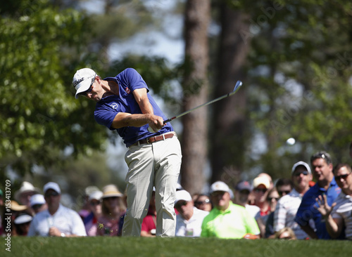 Australia\'s Adam Scott hits his tee shot on the fourth hole during ...
