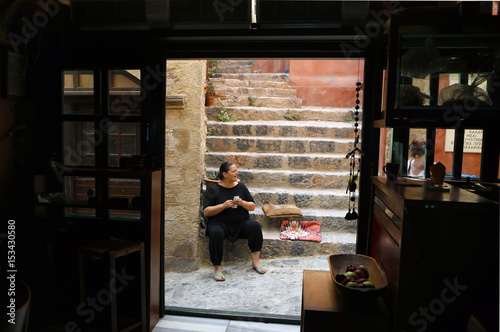 Anna Traiforou Sits Outside Her Bar Inside The Medieval Castle Of
