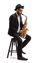 Jazz Musician Playing Saxophone And Sitting On Chair