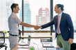 Positive business partners shaking hands