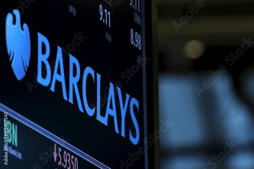 A Screen Displays The Ticker Symbol And Information For Goldman