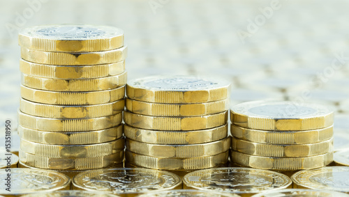 Fotografia, Obraz  British money, three pound coins descending stacks.