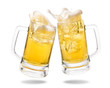 canvas print picture - Cheers cold beer with splashing out of glasses on white background.