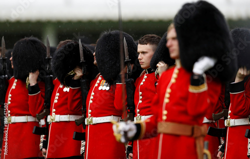 soldiers of the scots guards remove their bearskin hats after