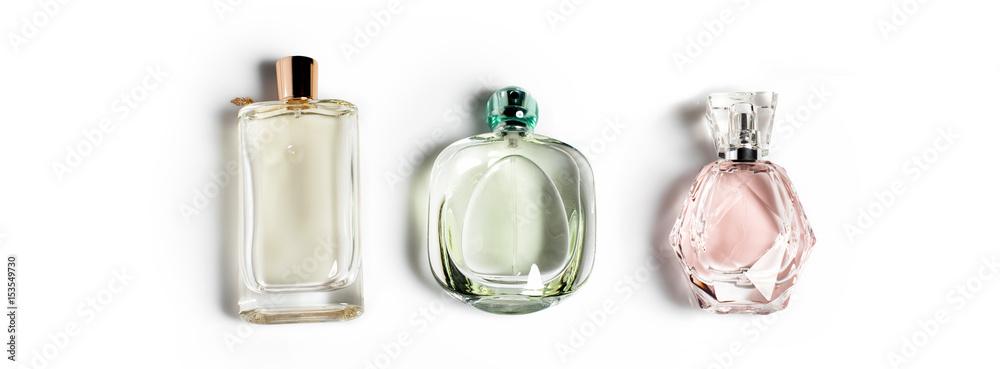 Fototapety, obrazy: Perfume bottles on light background. Perfumery, cosmetics, fragrance collection. Banner for website.