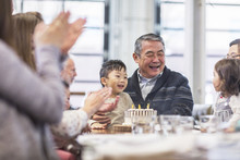 Multi Generation Family Celebrating Birthday In Restaurant