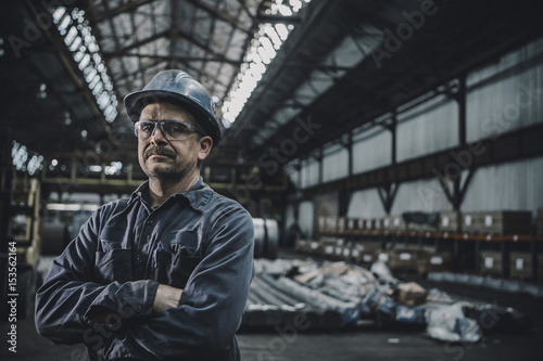 Portrait of male worker standing in metal industry