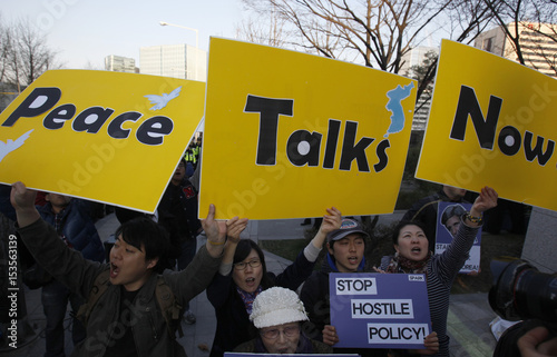 Anti-war civic group activists chant slogans during a rally