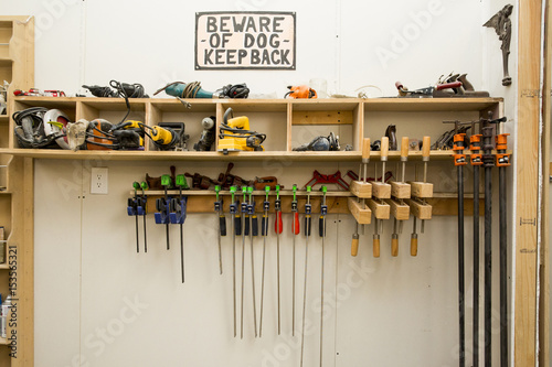 Foto op Plexiglas Wand Information sign by work tools on shelves at wall