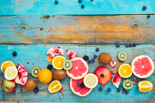 Colorful fruit on wood background