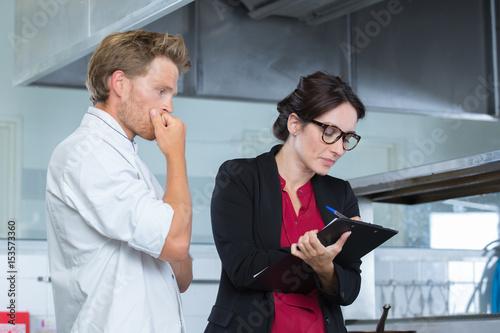 Fotografie, Obraz  building inspection with client
