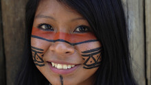 Closeup Face Of Native Brazilian Woman At An Indigenous Tribe In The Amazon