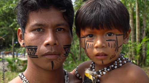 Father and Son at an indigenous tribe in the Amazon Canvas Print