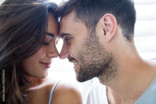 Fotografie, Obraz  Young couple romancing in bedroom