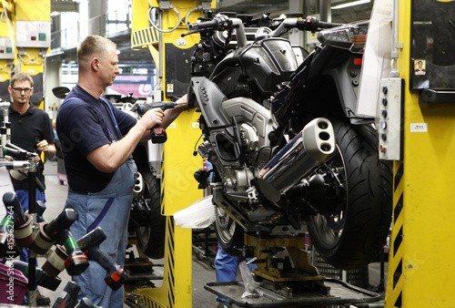 A BMW employee assembles a BMW motorcycle at the company's