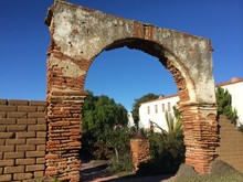 Large Archway Through Brick Wall