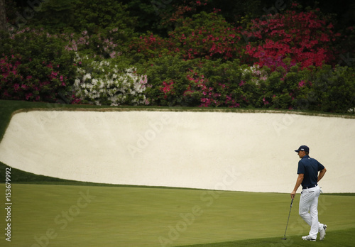 Jordan Spieth of the U.S. waits to putt on the 13th green during ...