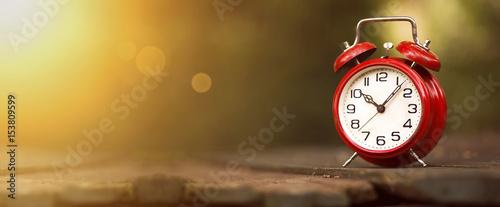 Time management concept - website banner of a vintage red alarm clock Canvas Print