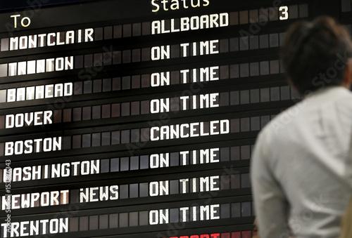 The train schedule board shows train service to Boston