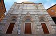 view of Duomo di Siena or Metropolitan Cathedral of Santa Maria Assunta in Siena, Tuscany, Italy.