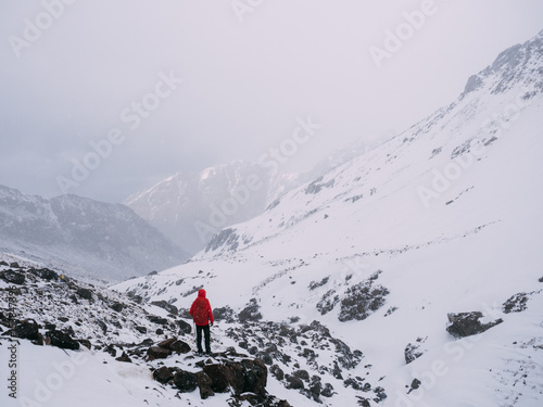 Fotobehang Bergen Anonymous person in snowy mountains