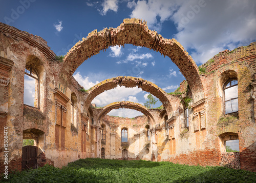 Poster Ruine Architectural remains with prominent arches at sunny day